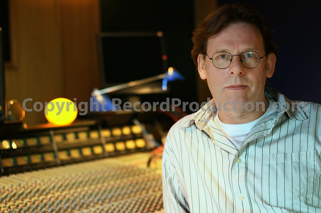 record producer Hugh Padgham behind his SSL console at his new private London recording studio